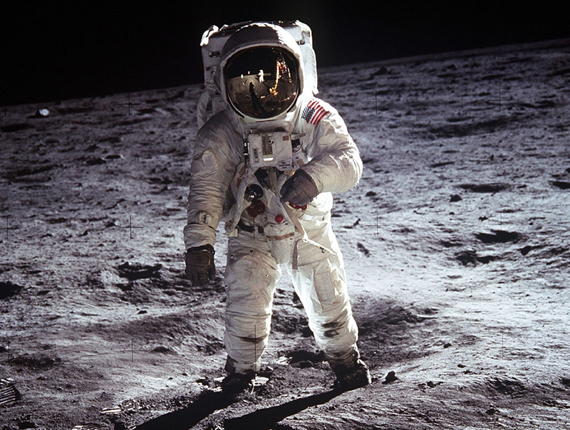 Iconic photograph of astronaut Buzz Aldrin, lunar module pilot, standing on the surface of the moon near the leg of the lunar module, Eagle, during the Apollo 11 moonwalk. Astronaut Neil Armstrong, mission commander, took this photograph with a 70mm lunar surface camera.