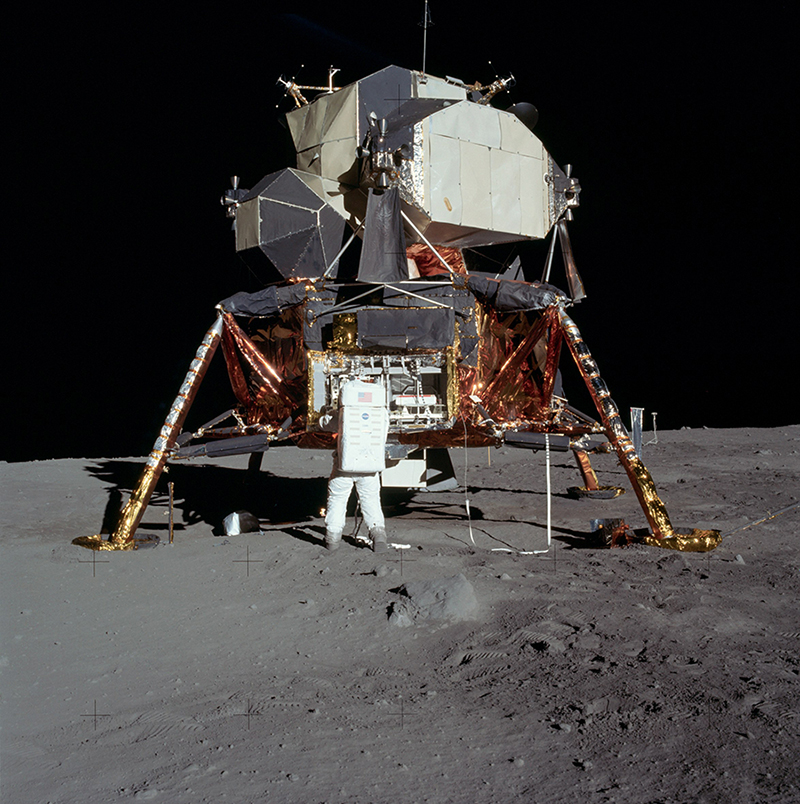 Photograph of Buzz Aldrin on the surface of the moon taken by astronaut Neil Armstrong. Aldrin is standing next to the Lunar Module and has his back to the camera.