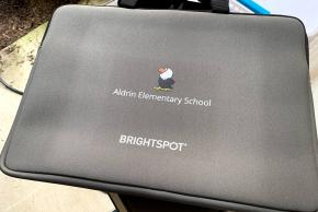 Brightspot computer bag donation for each student with Aldrin eagle
